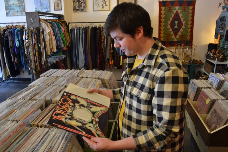 Leveret's Jesse Gertz takes in the glitz and grammar of Disco compilations at Moody Lords located at 566 Congress St. in Portland. Photo Credit: Kevin Steeves